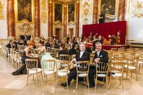 Members of the Vienna Hofburg Orchestra ready to perform the New Year's Concert 2021 in the Palais Liechtenstein.